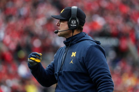Michigan head coach Jim Harbaugh talks to players during the second half against Ohio State at Ohio Stadium in Columbus, Ohio, Saturday, Nov. 24, 2018.