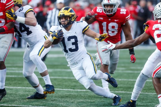 Michigan running back Tru Wilson runs against Ohio State during the second half at Ohio Stadium in Columbus, Ohio, Saturday, Nov. 24, 2018.