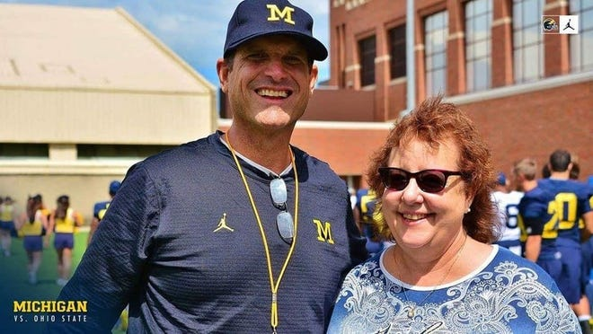 Michigan football coach Jim Harbaugh, left, and University of Michigan Marching Band Director of Operations Maggie St. Clair.