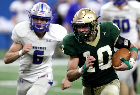 Jackson Lumen Christi running back #10 Nick Thomas breaks free as Montague #6 Brennan Schwarz gives chase.