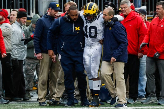 Michigan linebacker Devin Bush is carried off the field with a hip injury during the second half against Ohio State at Ohio Stadium in Columbus, Ohio, Saturday, Nov. 24, 2018.