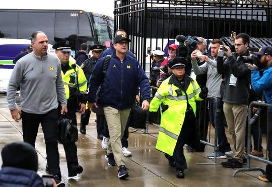 Michigan coach Jim Harbaugh arrives for the game against Ohio State Saturday, November 24, 2018 at Ohio Stadium in Columbus, Ohio.