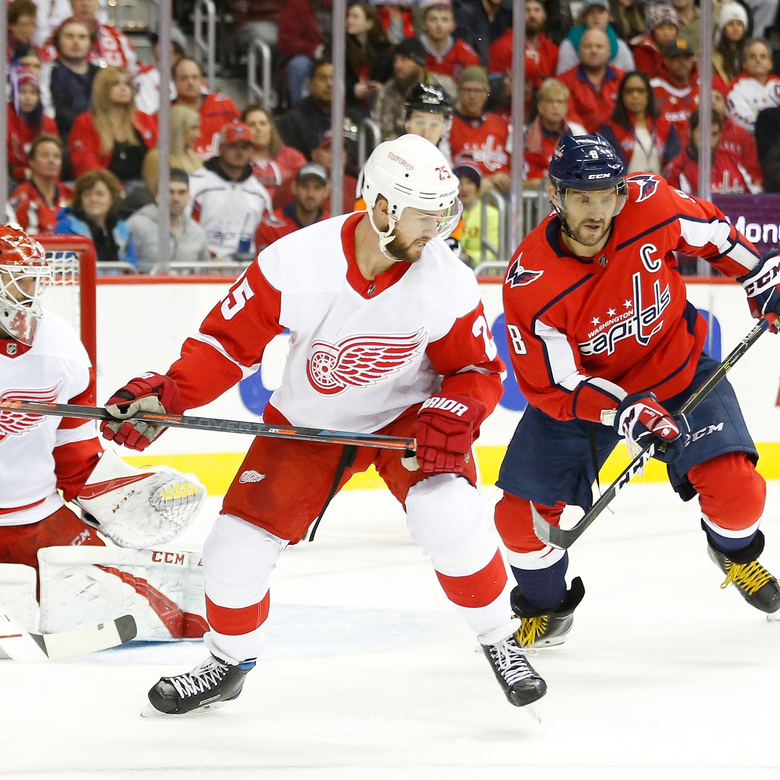 Capitals left wing Alex Ovechkin and Red Wings defenseman Mike Green battle for the puck in front of Red Wings goaltender Jonathan Bernier in the first period at Capital One Arena, Nov. 23, 2018. The Caps won, 3-1.