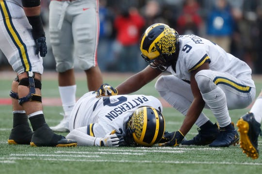 Michigan wide receiver Donovan Peoples-Jones (9) checks on quarterback Shea Patterson (2) during the second half against Ohio State at Ohio Stadium in Columbus, Ohio, Saturday, Nov. 24, 2018.