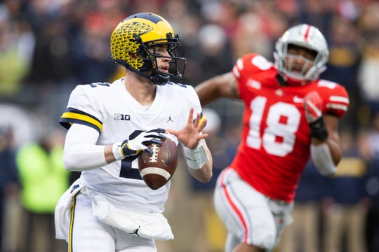 Michigan quarterback Shea Patterson looks for an open receiver under pressure from Ohio State defensive end Jonathon Cooper on Friday, Nov. 24, 2018, at Ohio Stadium.