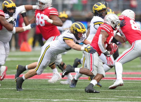 Michigan's Chase Winovich tries to tackle Ohio State running back Mike Weber during the first half Saturday, Nov. 24, 2018 at Ohio Stadium in Columbus, Ohio.