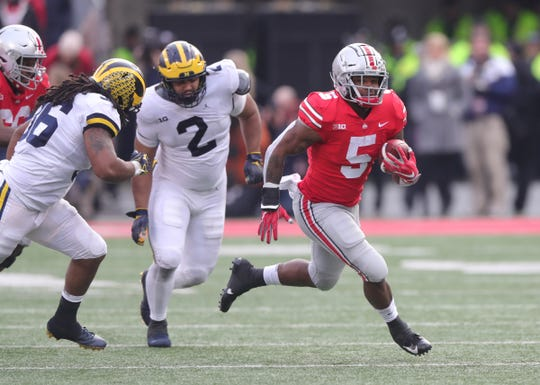 Michigan defenders chase Ohio State running back Mike Weber in the second half Saturday, Nov. 24, 2018 at Ohio Stadium in Columbus, Ohio.