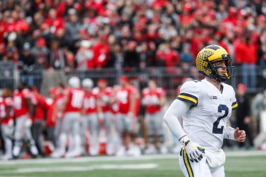 Michigan quarterback Shea Patterson runs off the field after a pass intercepted by Ohio State during the second half at Ohio Stadium in Columbus, Ohio, Saturday, Nov. 24, 2018.