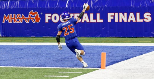 Edwardsburg #25 Caden Goggins runs into the end zone alone for the score after breaking through the Chelsea defense during second half action between Edwardsburg and Chelsea in division 4 MHSAA football final at Ford Field in Detroit on Friday November 23, 2018.Edwardsburg won the game 28-7.