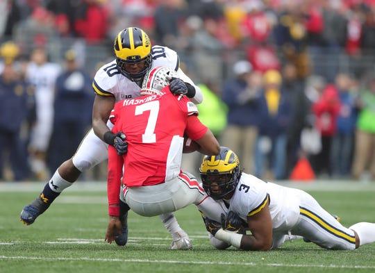 Michigan defenders Devin Bush, left, and Rashan Gary tackle Ohio State quarterback Dwayne Haskins last season.