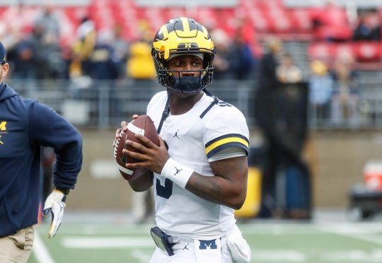 Michigan quarterback Joe Milton (3) warms up before the OSU game at Ohio Stadium in Columbus, Ohio, Saturday, Nov. 24, 2018.
