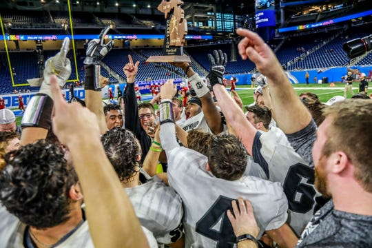 New Lothrop head coach Clint Galvas celebrates winning the Division 7 MHSAA State Championship at Ford Field in Detroit on Saturday, Nov. 24, 2018.