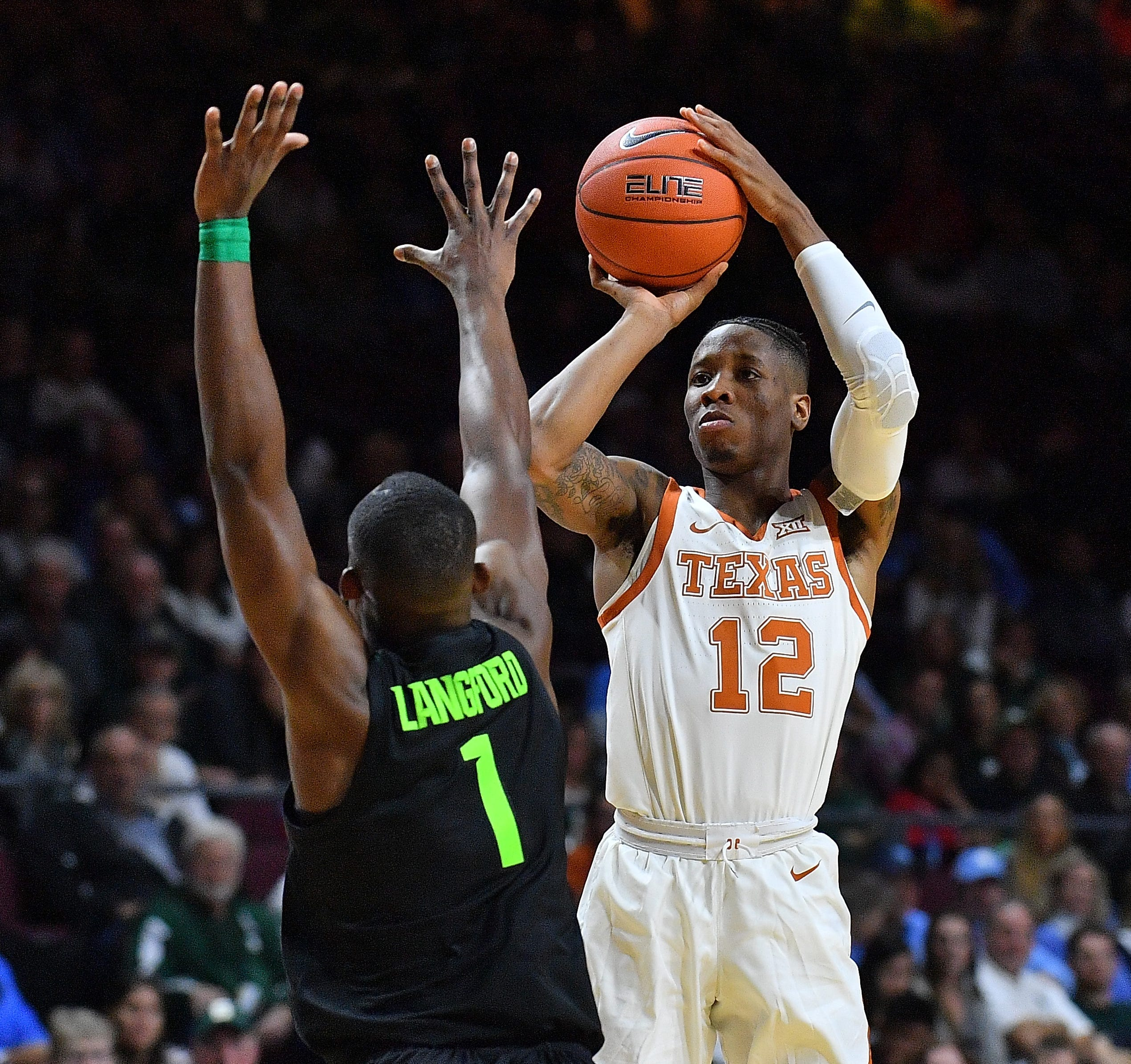 Texas' Kerwin Roach II shoots against Michigan State's Joshua Langford on Friday, Nov. 23, 2018, in Las Vegas.