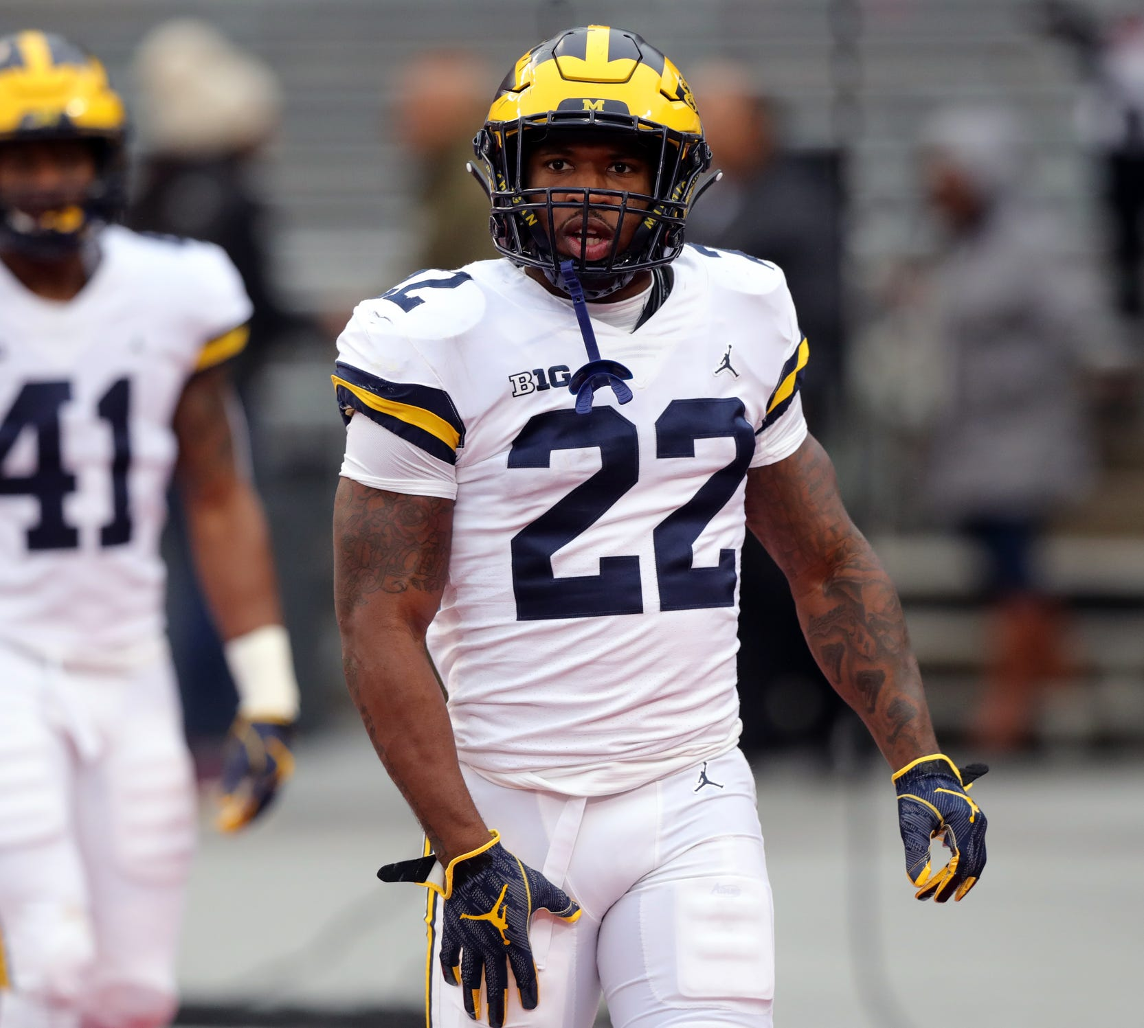 Michigan running back Karan Higdon warms up before action against Ohio State.