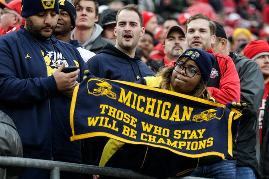 Michigan fans cheer for the Wolverines against Ohio State  during the first half at Ohio Stadium in Columbus, Ohio, Saturday, Nov. 24, 2018.