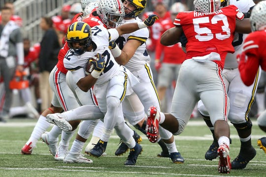 Michigan running back Chris Evans runs for a first down during the first quarter against Ohio State on Saturday, Nov. 24, 2018, at Ohio Stadium.