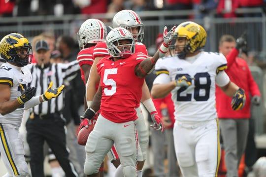Ohio State running back Mike Weber signals first down against Michigan in the second half Saturday, Nov. 24, 2018 at Ohio Stadium in Columbus, Ohio.