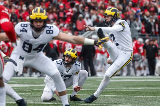 Michigan kicker Jake Moody (2) kicks an extra point from the hold of Will Hart against Ohio State during the second half at Ohio Stadium in Columbus, Ohio, Saturday, Nov. 24, 2018.