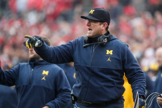 Michigan coach Jim Harbaugh reacts to a play against Ohio State during the first half at Ohio Stadium in Columbus, Ohio, Saturday, Nov. 24, 2018.