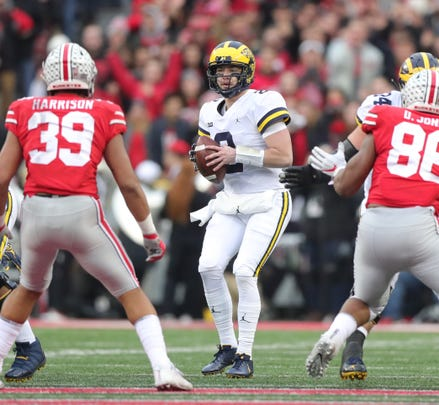 Michigan quarterback Shea Patterson looks to pass during first half action against Ohio State  Saturday, November 24, 2018 at Ohio Stadium in Columbus, Ohio.