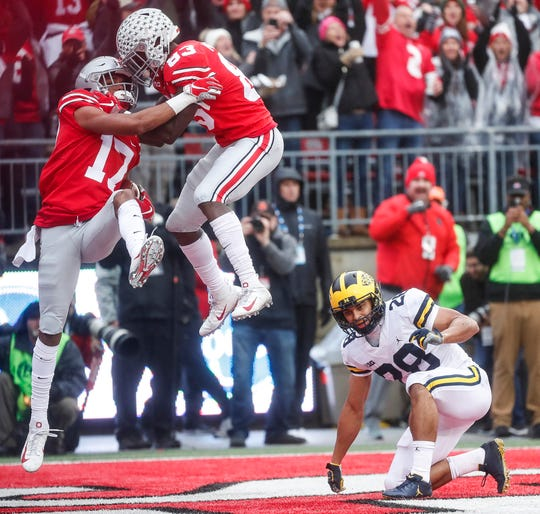 Ohio State wide receiver Chris Olave (17) and wide receiver Terry McLaurin (83) celebrate a touchdown against Michigan during the first half at Ohio Stadium in Columbus, Ohio, Saturday, Nov. 24, 2018.