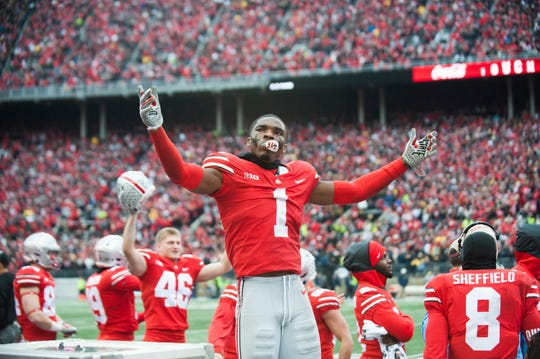 Ohio State cornerback Jeffrey Okudah plays to the crowd after a touchdown against Michigan.