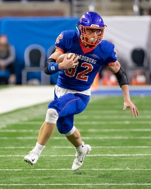 Edwardsburg's Dillon Hursh (32) runs up field against the Chelsea Bulldogs during a Division-4 High School Football State Finals game at Ford Field.