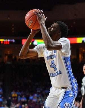Brandon Robinson of the North Carolina Tar Heels shoots against the UCLA Bruins.