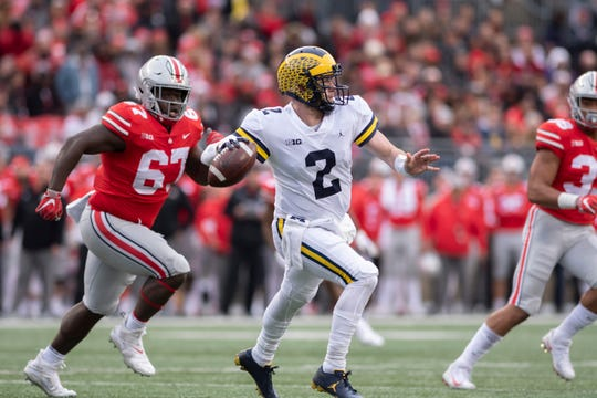 Michigan quarterback Shea Patterson throws a pass in the third quarter.