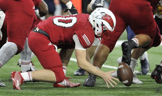 Chippewa Valley quarterback Tommy Schuster (10) mishandles the ball then recovers in the fourth quarter.
