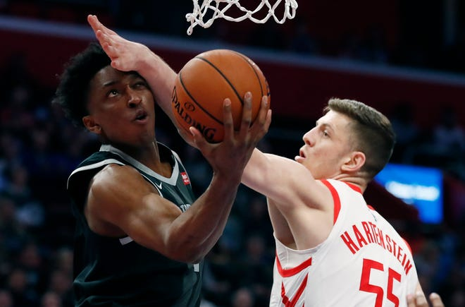Pistons forward Stanley Johnson makes a layup as Houston Rockets forward Isaiah Hartenstein (55) defends during the first half.