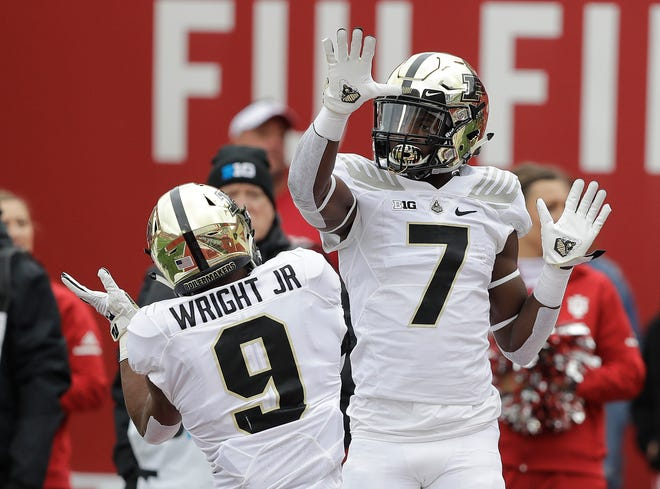 Purdue wide receiver Isaac Zico (7) celebrates a touchdown reception with Terry Wright during the first half against Indiana on Saturday.