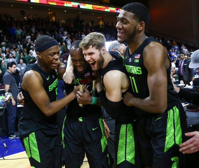 Michigan State players, from left, Cassius Winston, Joshua Langford, Kyle Ahrens and Aaron Henry celebrate their win over Texas in the Las Vegas Invitational championship game.