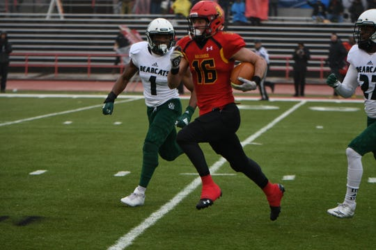 Ferris State receiver Sy Barnett runs for extra yards in Saturday's win.