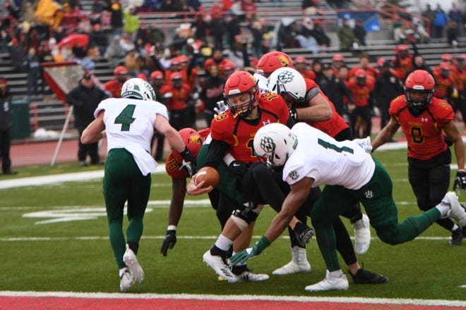 Ferris State freshman Evan Cummins (Livonia Churchill) is tackled by Northwest Missouri State on Saturday.