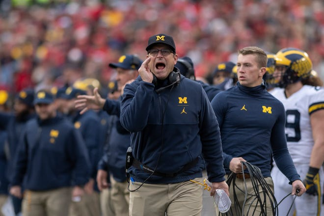 Michigan head coach Jim Harbaugh calls to the officials in the third quarter.