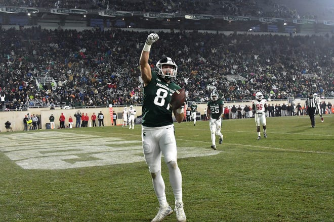Spartan tight end Matt Sokol (81) celebrates after he grabed a second quarter pass from Rocky Lombardi for a touchdown.