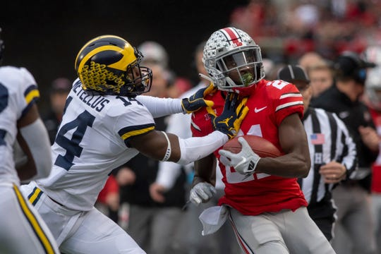 Michigan defensive back Josh Metellus pushes Ohio State wide receiver Parris Campbell out of bounds in the first quarter.