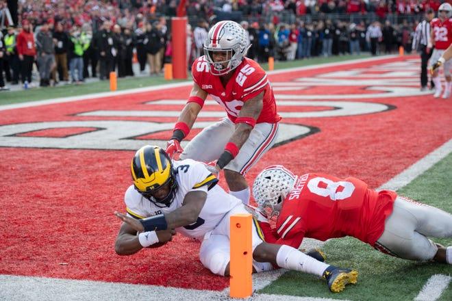 Michigan quarterback Joe Milton runs the ball for a touchdown in the fourth quarter.