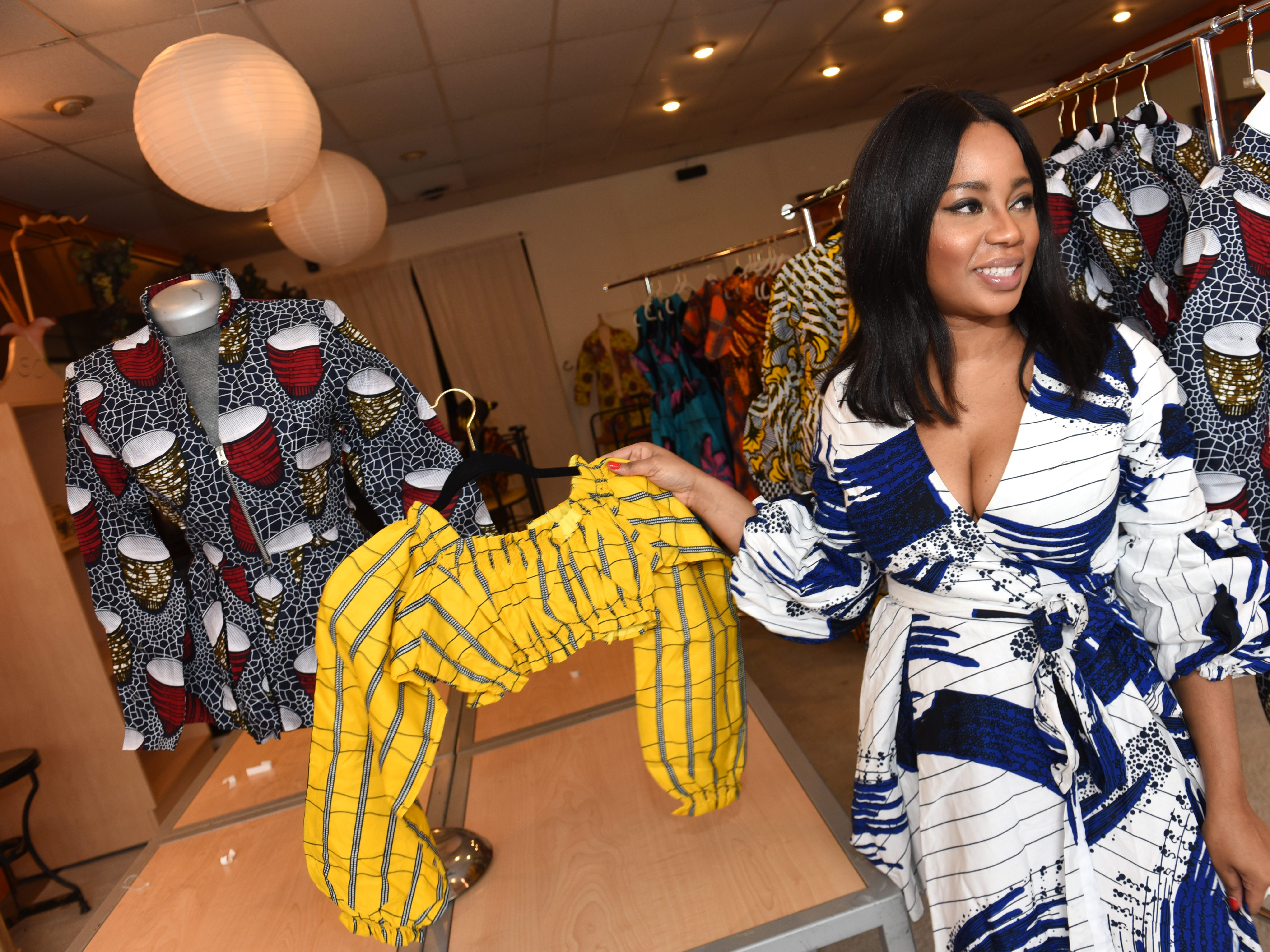 Matilda Harry, owner,  MohoStyle, shows her custom fashions at a pop-up store along the Avenue of Fashion on Saturday, November 24, 2018