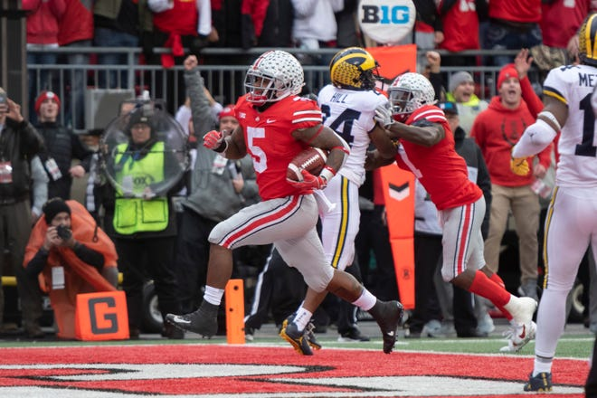 Ohio State running back Mike Weber runs the ball in for a touchdown in the third quarter.