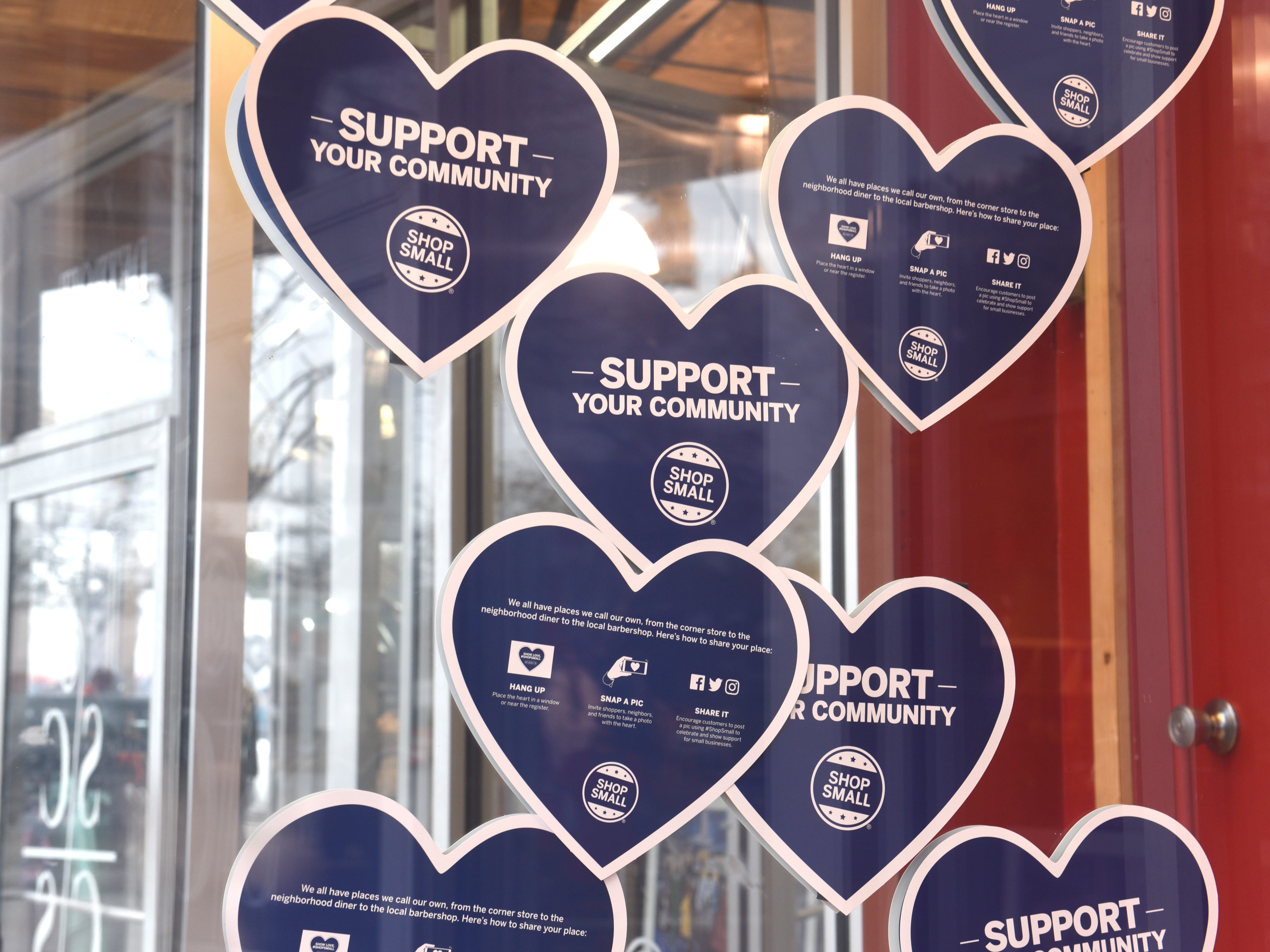 Storefronts display their Small Business Saturday hearts in support of business along the Avenue of Fashion.