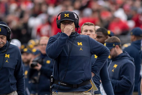 Michigan head coach Jim Harbaugh reacts after Ohio State blocked a punt and returned it for a touchdown in the third quarter.