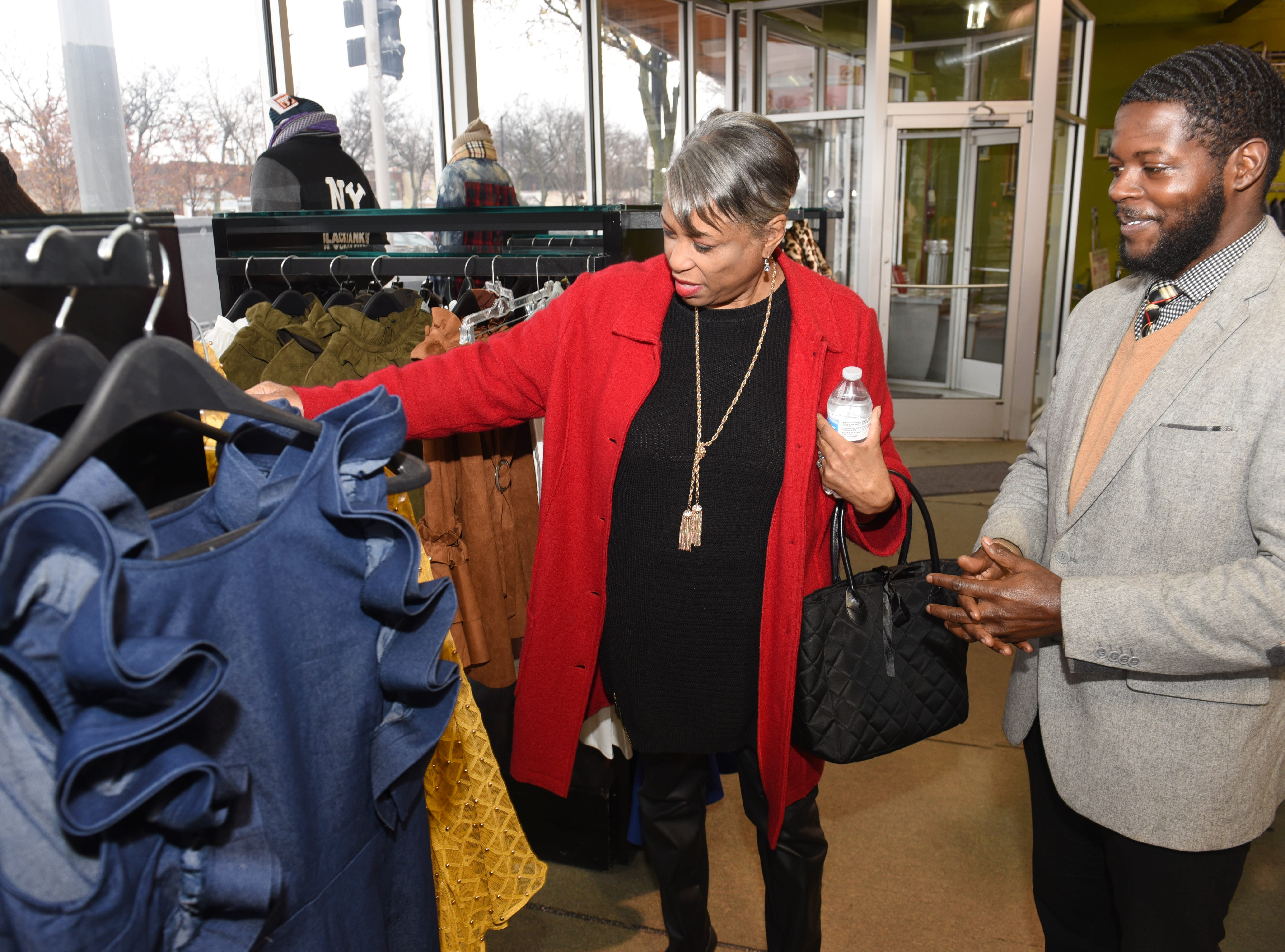 U.S. Rep. Brenda Lawrence, D-Southfield, is assisted by salesman Antonio Lewis at Simply Casual for Small Business Saturday.