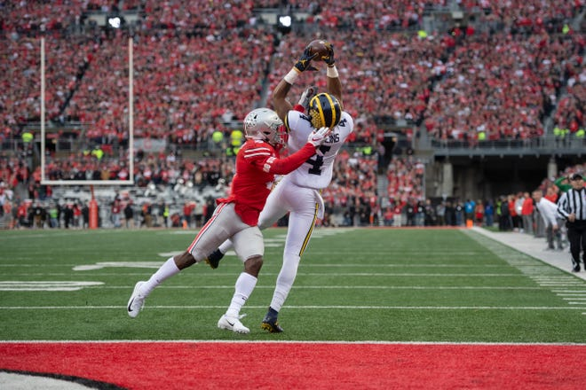 Michigan wide receiver Nico Collins makes a touchdown catch despite coverage by Ohio State cornerback Kendall Sheffield in the second quarter.