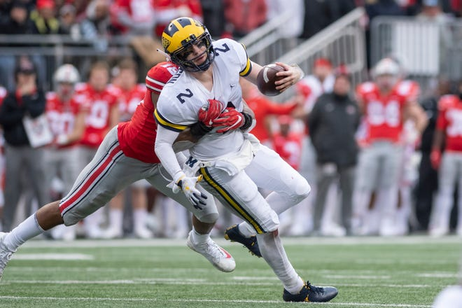 Michigan quarterback Shea Patterson was sacked three times in Saturday's loss at Ohio State.