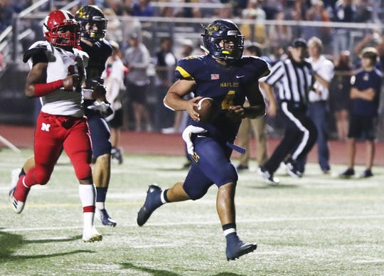 Naples High School's Elan Sommala scores a touchdown against North Fort Myers on Friday in the Class 6A regional final at Staver Field in Naples. Naples beat North 23-0.