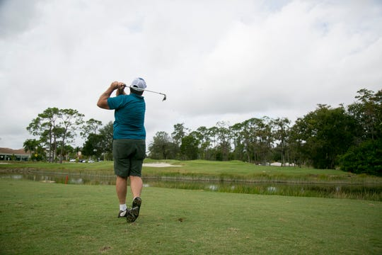 Chris Foust hits a shot onto the 18th green at Eastwood Golf Course in Fort Myers on Saturday, Nov. 24, 2018. The greens on the front nine holes have been renovated and are more elevated than before.
