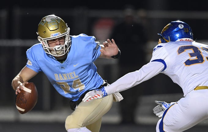 Daniel quarterback Tyler Venables (24) breaks the grasp of Wren's Jake Van Arsdale (33) during the third round of the class AAAA playoffs Friday, November 23, 2018, at Daniel High in Central.