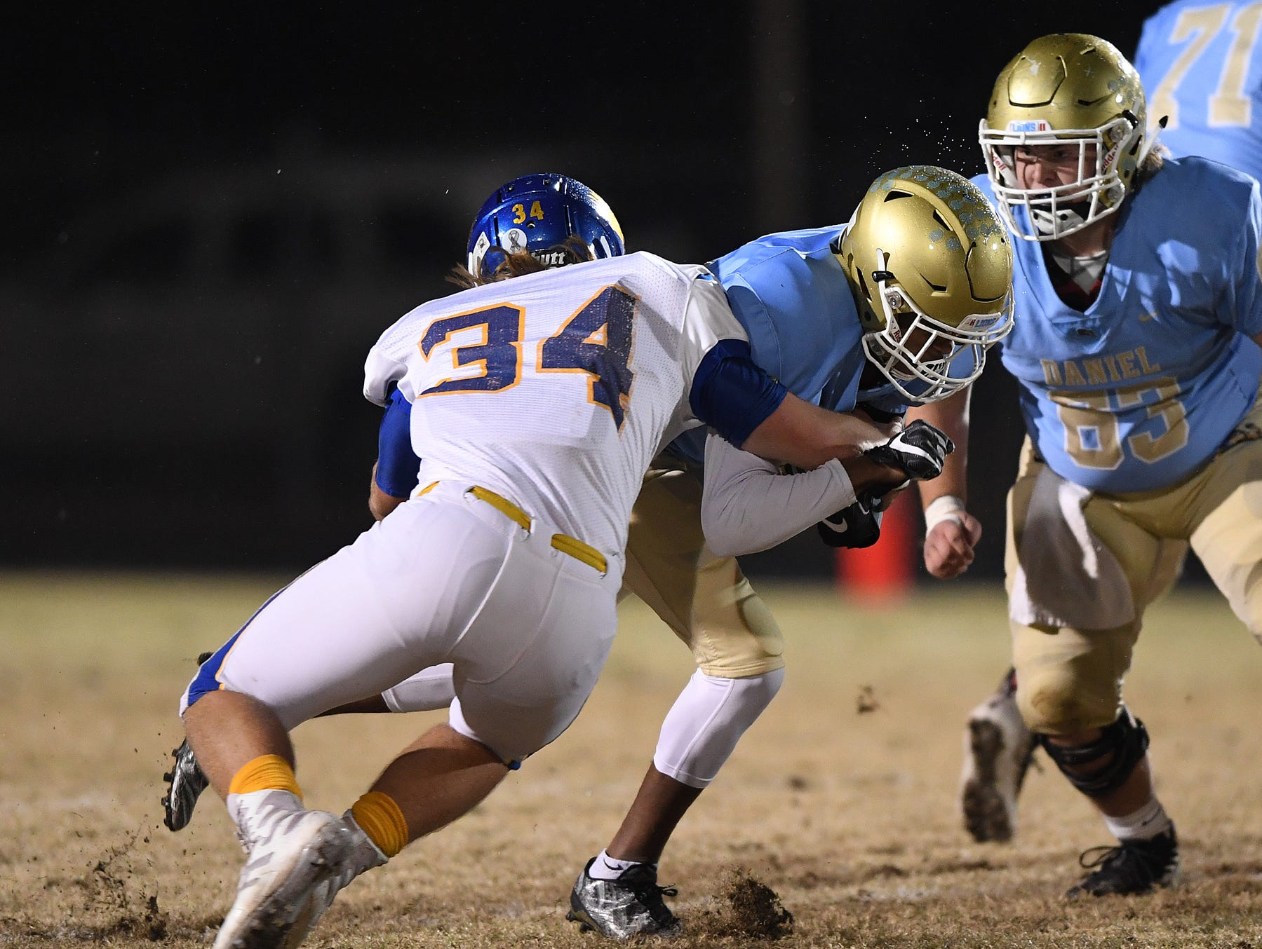 Wren's Jonathan Cobb (34) tries to stop Daniel's Billy Bruce (15) during the third round of the class AAAA playoffs Friday, November 23, 2018, at Daniel High in Central.